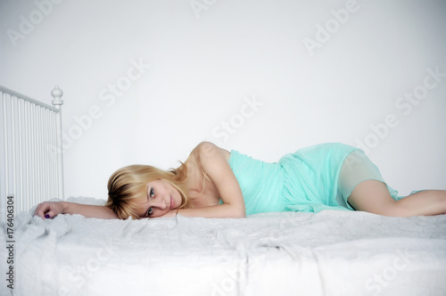Plakát Young beautiful girl resting on the bed