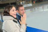at the hockey game - 176410329
