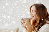 happy woman with cup of tea or coffee at home - 176411588