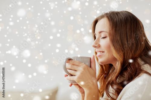 happy woman with cup of tea or coffee at home плакат