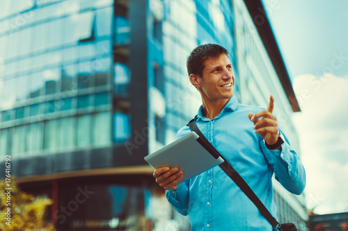 Young man on a business trip using navigation in the city