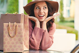 happy woman with shopping bags - 176418175