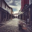 street of an Old Bazaar in Korca, Albania, table for coffee for twoz - 176433177