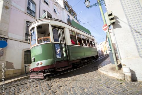 speeding historic tram lisbon portugal