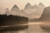 Lijang river and karst mountains in China on a foggy morning at sunrise. - 176436385