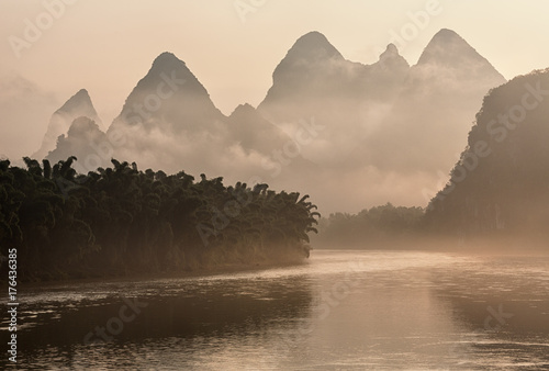 Lijang river and karst mountains in China on a foggy morning at sunrise Poster