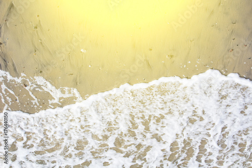 Papiers peints Jaune de seuffre white wave on a sandy beach toned