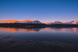 Landscape of a nature of a  pink sunset  in the reflection ocean mountains of Spitsbergen Svalbard near the Norwegian city Longyearbyen - 176440518
