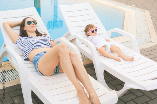 Sticker Endless summer. Cute baby and mother relaxing at sunbed