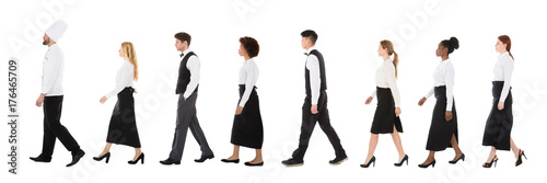 Young Restaurant Staff Walking In Row