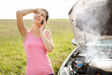 Woman Calling On Mobilephone For Road Service - 176466163