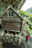 Tourist visiting Helleren houses in Jossingfjord, Norway - 176469715