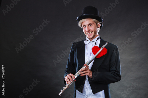 Póster Male flutist with flute and heart. Love melody