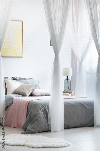 Gold painting in canopy bedroom