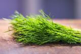 green dill on cutting desk soft focus - 176481151