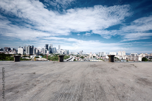 empty concrete floor with cityscape of modern city Poster