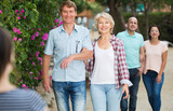 mature males and females walking on holiday - 176484577