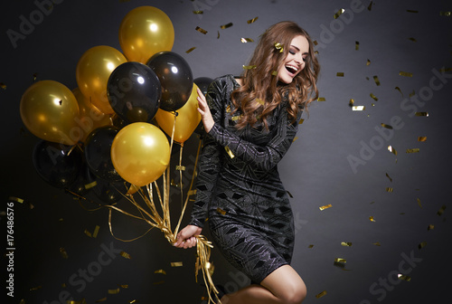 Cheerful woman with balloons laughing . - 176486576