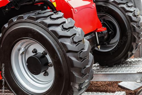 Fotobehang Trekker wheels of the tractor drive onto the loading dock