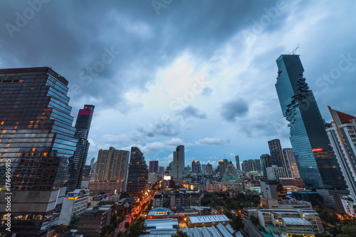 Aerial view of Bangkok downtown under the storm and cloudy sky Poster