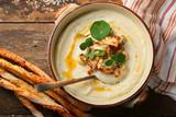 Hot white cream-soup in bowl