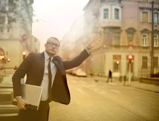 Businessman calling for a taxi