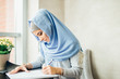 beautiful Muslim woman working with documents. business, lifestyle concept