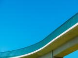 Pedestrian bridge over a busy highway - 176503515