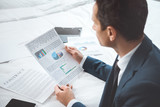 businessman reading paperwork - 176503780