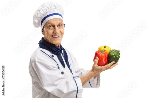 Elderly chef with peppers