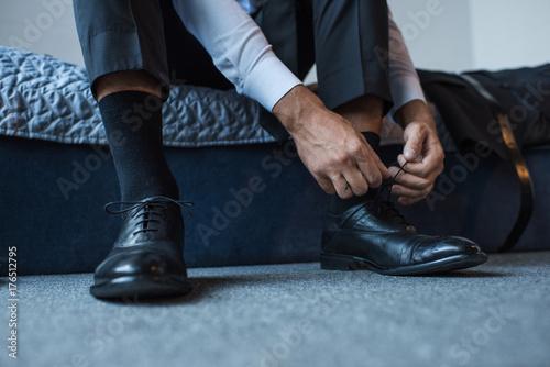 Man tying shoelaces Poster