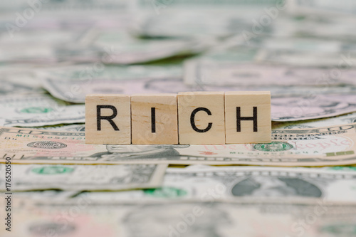 """the word """"RICH"""" written in wooden block letters Poster"""