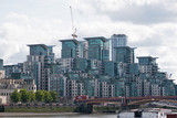 Postmodern architecture dominates a Thames riverbank in central London - 176525128