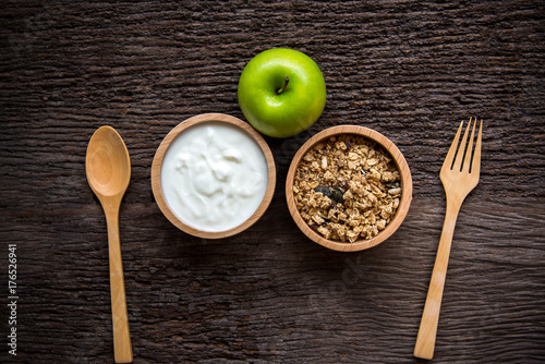 Aluminium Milkshake Yogurt with muesli for breakfast in the morning, loss weight and green apple diet slimming for women, old wood background. Diet and Healthy Concept