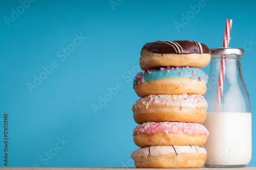 Baked donuts and glass jar with milk Poster