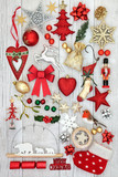 Christmas decorative symbols with new and old fashioned bauble decorations, holly, mistletoe, fir and mince pie on rustic white wood background. - 176539767
