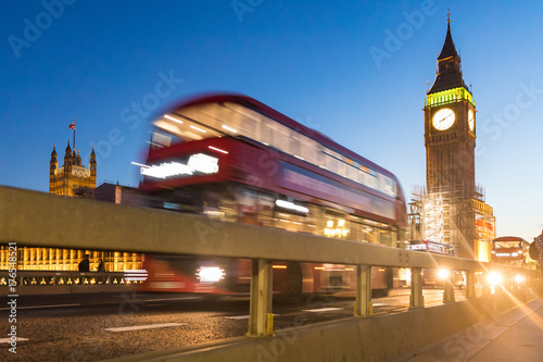 Big Ben and red bus in London at dusk