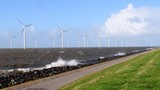 Wind turbines in an October fall storm at the IJsselmeer - 176554337