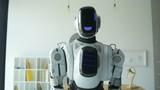 Confident robotic machine moving toward camera - 176573384