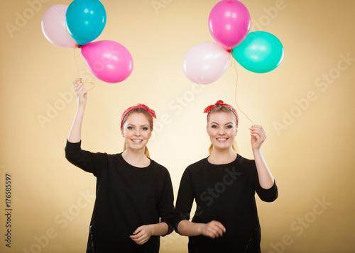 Women like a little girls want fly away by balloons.