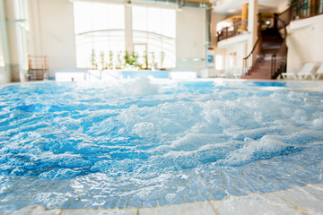 Waves and splashes in warm spa jacuzzi with nobody around © pressmaster
