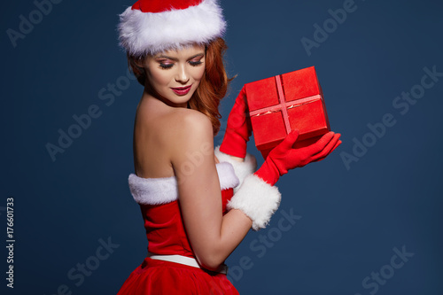 Portrait of beautiful sexy girl wearing santa claus clothes плакат