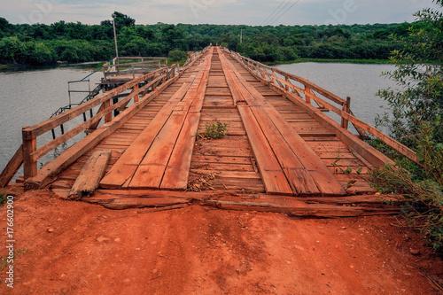 Foto op Canvas Baksteen Brazil Pantanal wood bridge