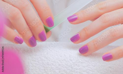Fotobehang Manicure Female hands making nail manicure