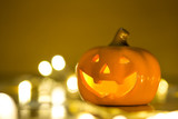 Haunted spooky pumpkin decorate for Halloween festival in autumn with bokeh light background. - 176616376