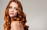 Beautiful model girl with long red curly hair .Red head . Care and beauty hair products   - 176629921