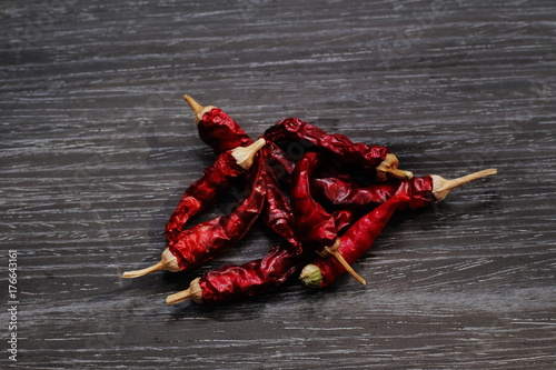 Fotobehang Hot chili peppers red pepper and chili on wood table mexican