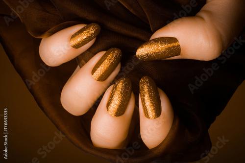 Fotobehang Manicure shiny golden nails manicure