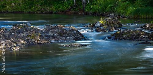Papiers peints Bleu vert Rocky river Bank with mixed forest.