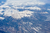 Snow-covered mountains viewed from airplane - 176654729